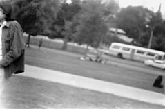 h6-68 14 (ndpa / s. lundeen, archivist) Tags: nick dewolf nickdewolf bw blackwhite photographbynickdewolf film monochrome blackandwhite city summer 1968 1960s 35mm boston massachusetts candid streetphotography citylife people beaconhill park common bostoncommon youngpeople path pathway walkway man youngman blur blurry focus car vehicle automobile bus outoffocus july july4