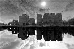 Un reflet en béton (Chrixcel) Tags: sun reflection abandoned rain clouds soleil eau noiretblanc pluie reflet abandon nuages 180° usine ciment flaque urbex