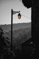 Morning light (Stray Croc) Tags: city morning summer bw mist france history silhouette magazine streetlight outdoor clearsky selectivecolour mountainrange midipyrenees