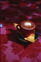 Espresso Macchiato (Elisabeth Gil) Tags: pink light red flower cup coffee yellow milk tallinn break tablecloth nikonfm2 fujicolorsuperia200 espressomacchiato