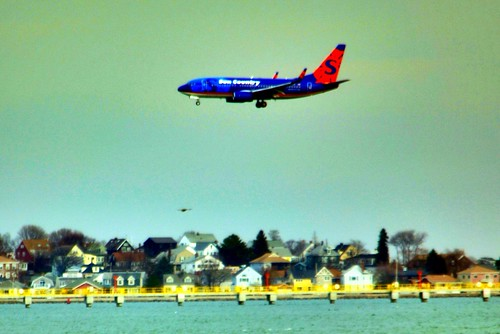 Plane over the harbor