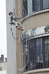 Going down (Roving I) Tags: vertical workers vietnam barefeet suspended ropes saigon abseiling hcmc hochiminh helmets harnesses