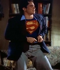 Clark Kent changing into Superman (Guardian Screen Images) Tags: new blue red man comics book dc kent comic brothers dean books super wb tights el superman 1993 suit warner clark hero superhero cape 1997 network adventures tight bros lois spandex lycra kal the cain kalel