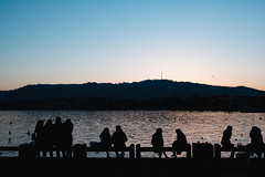 Crowdlingering (Ivan Rigamonti) Tags: zurich streetphotography crowd sunset