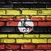 National Flag of Uganda on a Brick Wall