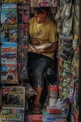 Checking accounts (karinavera) Tags: travel sonya7r2 street lima perú perou photography diarios kiosk calle newspaper people kiosks day daytime peru