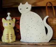 ^..^ CATS ^..^..... (Daisy.Sue) Tags: autumn2016 cats sitting lotiondispenser ceramic yellowgoldblackwhite nightlight white unglazedceramic