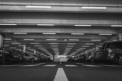 Underground Car Park (Howie Mudge LRPS BPE1*) Tags: carpark vehicles floor road lines angles perspective lights blackandwhite blackwhite bw mono monochrome monochromatic sony sonya7 compactsystemcamera mirrorlesscamera aberystwyth ceredigion wales cymru uk
