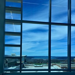 the sky from South Hill (Lady Goshen) Tags: flickrfriday hdr glass window projectweathersubmission cloudy campus frame windowframe sky ithaca lake ithacacollege reflections highlevel cirrus cayuga cayugalake fingerlakes upstatenewyork