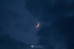 Crescent moon between clouds (mythicalireland) Tags: crescent first moon lunar new evening dusk sky clouds astronomical heavens astronomy astrophotography
