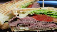 Roast beef panini with provolone and garlic mayo (Coyoty) Tags: cornercafe tunxiscommunitycollege farmington connecticut ct college cafe food roastbeef beef meat panini grilled sandwich provolone cheese garlic mayo mayonnaise bread lines tomato lettuce red green brown black melty bokeh diagonal close closeup color obligatory ogt ort sometimessavory