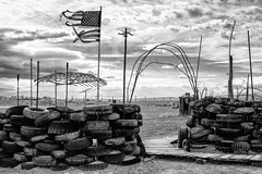 2018 (dshoning) Tags: usa flag tattered 2018 bw despair tires clouds darkness depression compound neglect