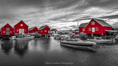 The fishing village of Bud, Norway (Marco Carbone Photography) Tags: norway sea boats red travel sky europe nikon nord photooftheday allaperto architecture norvegia landscapes cielo viaggi rosso norge atlantic