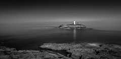 Dead Calm (Mick Blakey) Tags: shoreline slowexposure calm peaceful rocky trinityhouse blackwhite silky coastline cornwall monochrome cornish contrast coastal rocks lighthouse seascape reflection coast godrevy surreal