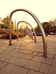 Convergence (35mmMan) Tags: vanishingpoint sunset stalbans urban streetfurniture steel hoops repetition patterns huaweip9plus cameraphone convergence backlit