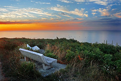 couple of stone benches with beautiful view of sea at sunset (Mikel Martnez de Osaba) Tags: ocean sunset sea two sky cliff beautiful stone clouds bench relax landscape boats twilight fishing bush chair couple colorful peace view dusk seat peaceful calm sit romantic rest lonely recliner idyllic tranquil getxo sopelana