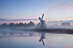 charming Dutch windmill in morning mist at sunrise (Olha Rohulya) Tags: morning travel pink blue autumn sunset sky cloud mist holland reflection fall nature water netherlands windmill dutch misty fog rural sunrise river season relax landscape outside outdoors countryside early canal scenery silent view farm traditional scenic culture nobody nopeople surface calm farmland reflect groningen spiritual tranquil