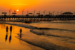 Down by the Pier, Huanchaco (Geraint Rowland Photography) Tags: ocean travel sunset sea people sun love sol peru water sunshine kids canon walking pier seaside surf day waves pacific cloudy lifestyle sunny surfing entertainment passion surfers trujillo peruvian huanchaco geraintrowland