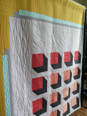 City Planner quilting (Quiltachusetts - Heather Black) Tags: modern contemporary quilt quilting 3d yellow mustard aqua coral orange grey gray solid geometric quiltachusetts patchwork magazine pattern design