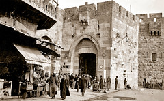 21 May 1941 - Australian troops, tourists & traders at the ancient Jaffa Gate entrance to the Holy City of Jerusalem (aussiejeff) Tags: city ww2 army soldier war tourist thomasbeazley jaffa vintage canoscan8800f jeffc tombeazley שעריפו‎‎ shaaryafo بابالخليل‎‎ babalkhalil babmihrabdawud davidsgate aussiejeff arab jerusalem tarboosh armenianquarter australia holy middleeast sepia restore