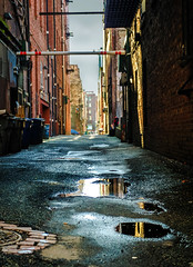 walking backwards (wrapped in dreams) Tags: reflections rain puddle seattle