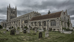 Holy Trinity Church (David Feuerhelm) Tags: outdoors nikkor wideangle colorefex building church tower windows cemetery graves tombstones longmelford suffolk colour d7100 england sky drama