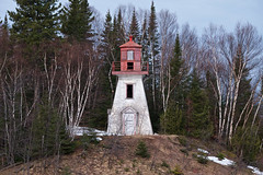 coppermine point lighthouse (twurdemann) Tags: abandoned architecture canada circa1910 clapboard copperminepointlighthouse decay derelict forest fujixt1 hibbardbay highway17 hill kilometer1154 lakesuperior landscape lighthouse morning northernontario ontario pyramidal red scenic spring toad tower transcanadahighway trees white woodframe xf55200mm