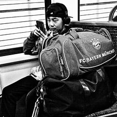 the fan (j.p.yef) Tags: peterfey jpyef yef people tourist mobil baggage metro ubahn germany hamburg train football soccer monochrome bw sw travel fan