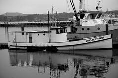 old boat (railcrew2) Tags: monochrome bw blackandwhite sony nex3n newport yaquina head boats bridge