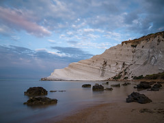 Scala dei Turchi Sunrise (Blueocean64) Tags: italy italia sicily sicilia agrigento realmonte siculiana sunrise longexposure mer mare mar sea beach coastal seaside seascape shore water eau calme serene quiet peaceful nature natura rocks scaladeiturchi outdoor extérieur landscape paysage paisaje paesaggio sky ciel nuages clouds cloudy shadows light winter blue orange panasonic g5 explorer 美丽 艺术 摄影 日落 意大利 旅游 景观 天空 探索