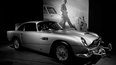astonmartin db5 jamesbond goldfinger movie moviecar louwmanmuseum cars auto automobile coches vehículos vehicle automóvil carros car voiture transportation transport museums classiccars vintageautomobiles antique old vehículosclásicos denhaag thehauge netherlands holland nederland southholland europe blackandwhite monochrome bw monomonday seanconnery ianfleming spy secretagent british britishcars