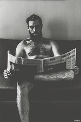 Newspaper. (Ludovic Mühlhauser) Tags: man human boy male portrait newspaper news day nude nudity hidden beard bearded inside monochrome canon canoneos70d conceptual story blackandwhite young wall write troyes champagne aube france europe world earth universe humanity peace love friendship fraternity brotherhood liberty free