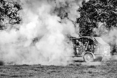 Defat in Sight (lifeless567) Tags: black white war ww2 reenact clouds smoke explosion dust old retro jeep gun weapon canon eos 70d united kingdom event outdoor outdoors