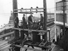 City Light workers at Western and Wall, 1927 (Seattle Municipal Archives) Tags: seattlemunicipalarchives seattle publicutilities electricutilities electricity lineworkers seattlecitylight workers working powerlines belltown waterfronts 1920s