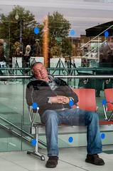 40 winks in a window (sasastro) Tags: street candid norwich theforum man sleeping pentaxk5iis