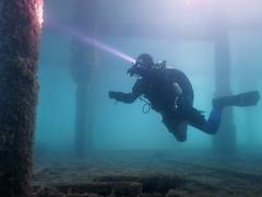 Diver under swanage pier (MatYts) Tags: swanage pier dorset uk diving scuba underwater diver torch beam light sea legs bsac marine blue south coast dry suit