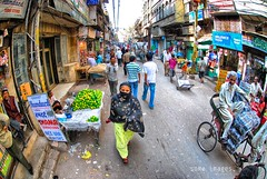 Looking up (Soma Images) Tags: street new old travel woman india jason streets up look scarf walking photography back women warm looking market delhi indian muslim crowd photojournalism images commercial license use vendor soma hindu cultural hindi crowded backstreets vendors chandni chowk somaimages somaimagescom