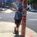Reading A Book Against Telephone Pole