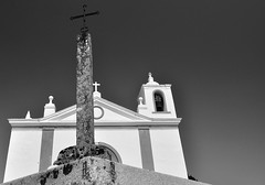 Crosses in B&W (Carla Robalo Martins) Tags: bw white portugal church rock branco cross bell cruz igreja granite polarizer alentejo pedra travelogue sino pavia musictomyeyes vora granito polarizador finegold addictedtoflickr golddragon vivalavida peaceaward flickrbronzeaward heartawards platinumheartaward goldstaraward gnneniyisithebestofday discoveryphotos abovealltherest dragondaggerphoto dragonflyawards atmphotography absolutelyperrrfect aboutiberia divinecaptures mygearandme blinkagain niceasitgets thelooklevel1red redlevelno1