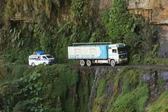 Lorry and Van Dangerous North Yungas Road Death Road Bolivia (eriagn) Tags: road travel flowers trees winter snow black mountains bus southamerica nature car animal river spectacular landscape photography monkey cyclists stream traffic wildlife bolivia erosion adventure tropical ravine endangered cloudforest van lush subtropical panning narrow lapaz sanctuary spidermonkey miners highaltitude lorries dryseason yungasroad deathroad aliplano lasendeverde eriagn ngairelawson ngairehart wildlifeanimaltrafficking rescuedwildlifeanimals