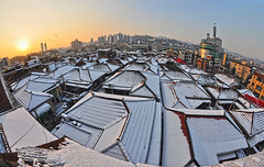winter sunset (fidel.2012) Tags: winter sunset sun snow cityscape bluesky seoul southkorea residentialhouse mountainsilhoutte snowcoveredtheroofofhouses