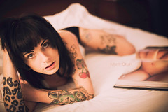 Book full of pictures (_vonStein) Tags: woman color girl tattoo book cherries warm bodyparts bambibrachial vision:sunset=0603 vision:outdoor=0557 vision:sky=0619