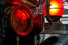 Red Glow (ramseybuckeye) Tags: central ohio fire museum columbus pentax art life sigma macro 50mm 28 50 lantern red light glow gauge wagon