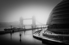 A Man About Town (TS446Photo) Tags: london fog d810 city tower bridge thames cityhall hall architecture building street man zeiss more wet reflection weather contrast grim day out streetphoto photography nikkor fineart