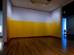 Yellow Ochre Room (Steve Taylor (Photography)) Tags: yellowochreroom simonmorris art minimalist blue yellow brown orange light wooden floor newzealand nz southisland canterbury christchurch glow silhouette lady woman gallery