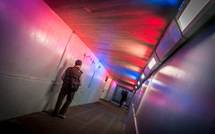 Patriotic Underground (DobingDesign) Tags: redwhiteblue colours tunnel light lighting reflection lines perspective angle person walking pedestrian london patches