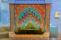 A colorful public drinking fountain in Chefchaouen Medina (adventurousness) Tags: bluecity chefchaouenthebluepearl thebluecity blue chaouen chefchaouen color morocco rainbow travel fountain