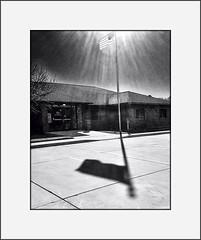 Bright morning (Bob R.L. Evans) Tags: flag usflag sky shadow building ipadphotography