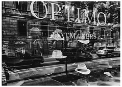 Optimo Hatmakers (swanksalot) Tags: hat hats haberdashery chicago storefront window optimo blackandwhite bw tweeted hatmaker