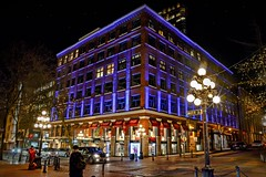 WATER STREET,  Historic  GASTOWN (Christie : Colour & Light Collection) Tags: waterstreet historic history vancouver bc canada leckiebuilding canadahistoricsite canadianhistoricsite gastown edwardianera britishcolumbia nightphotography cobblestone commercialwarehouse storefront c1913 canadian street lamppost red purple blue lighting night brick stonework nightlighting expore photographer photography dslr nikon